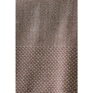 Asterlark merino wool throw blanket in brown with wing weave pattern on the borders of two sides