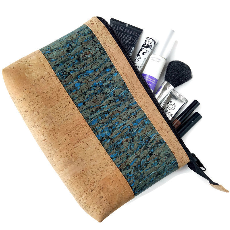 cork makeup bag laying on side with make up spilling out