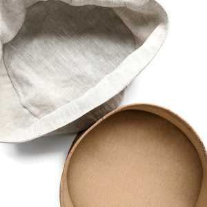 Round soft cork fabric basket with linen insert