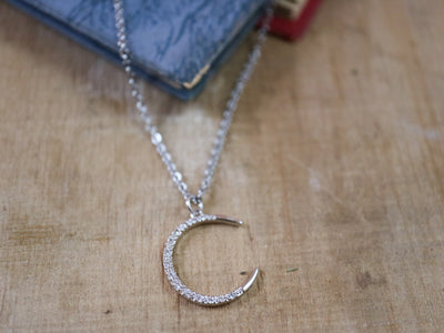 Silvery art nouveau moon necklace