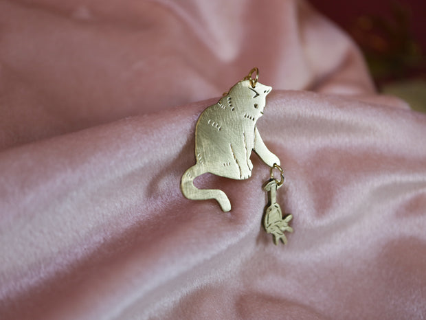 Slowly moves paw toward your glass cat hand sawed & engraved brass necklace