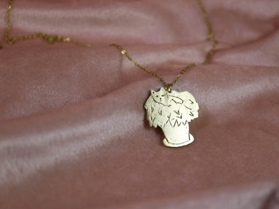Master of disguise cat hand sawed & engraved brass necklace