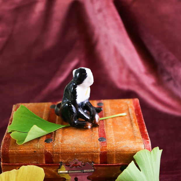 Small sitting capuchin monkey figurine