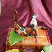 Small standing South American coati figurine