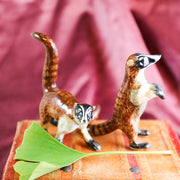 Small walking South American coati figurine