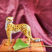 Small standing cheetah figurine