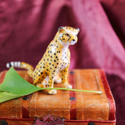 Small sitting cheetah figurine