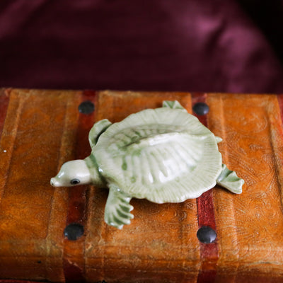 Miniature swimming turtle figurine