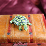 Miniature green turtle figurine