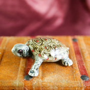 Miniature grey turtle figurine
