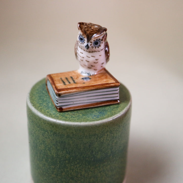 Miniature bookish owl figurine