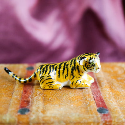 Miniature laying tiger figurine