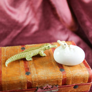 Miniature hatching alligator figurine