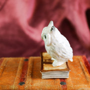 Miniature grey bookish owl figurine