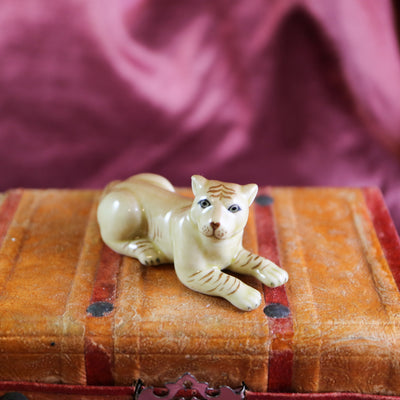 Miniature miss lion figurine