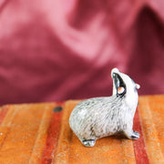 Miniature curious badger figurine