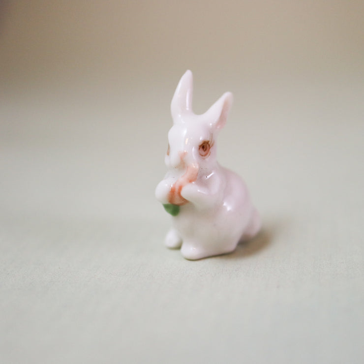 The tiniest carrot carrying bunny figurine