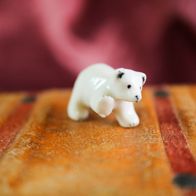 The tiniest miniature polar bear figurine
