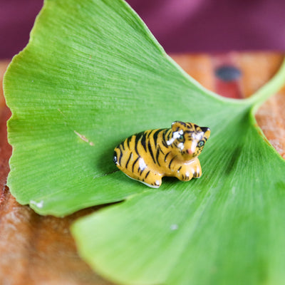 The tiniest miniature tiger figurine