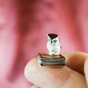 The tiniest miniature owl figurine
