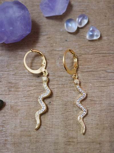Sparkling golden serpent earrings