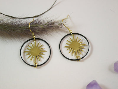 Turning gold star earrings