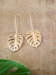 Long golden monstera leaf earrings
