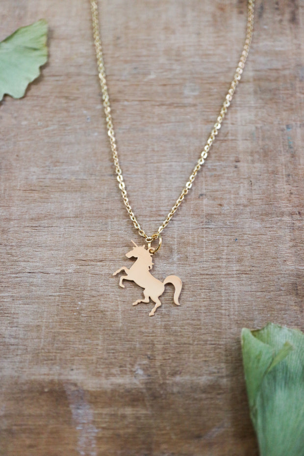 Golden unicorn necklace