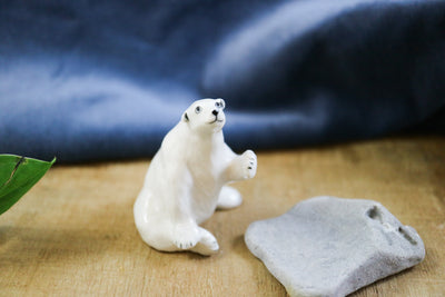 Small sitting polar bear figurine