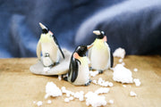 Miniature king penguin with baby figurine