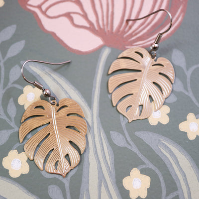 Silver monstera earrings