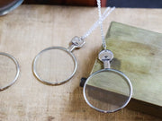Antique opticians test lens necklace