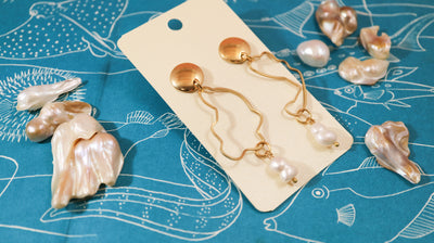 Soft coral golden earrings