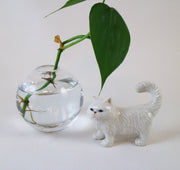 Miniature fluffy white cat figurine