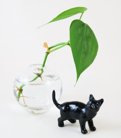 Miniature black cat figurine