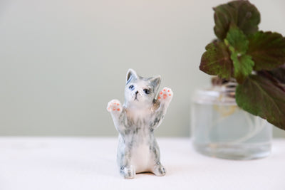 Miniature standing cat figurine