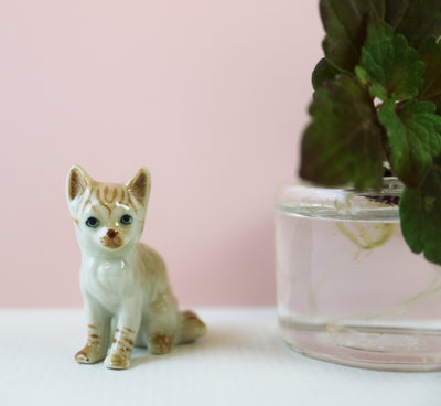 Miniature sitting ginger cat figurine