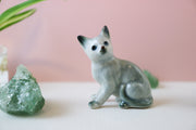 Miniature sitting cat figurine