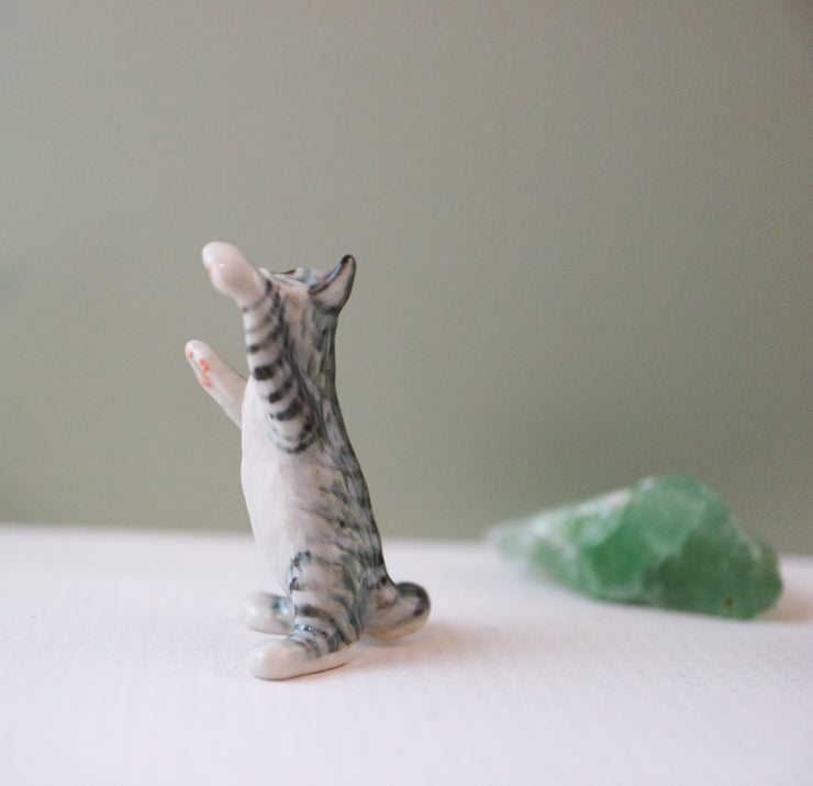 Miniature playful cat figurine