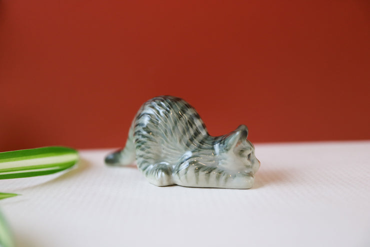Miniature sneaking cat figurine