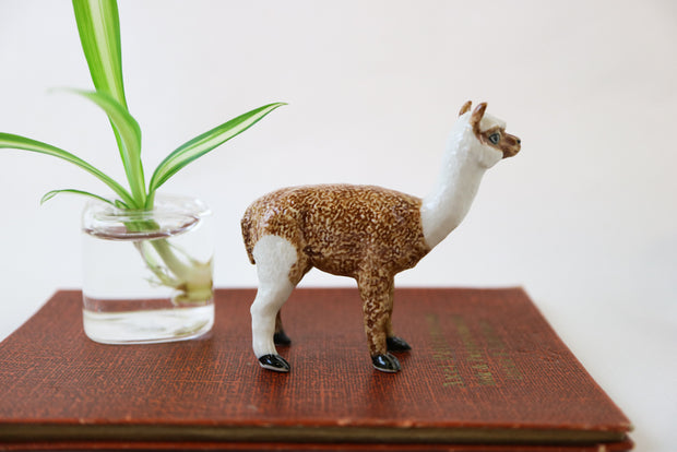 Small brown mask alpaca figurine