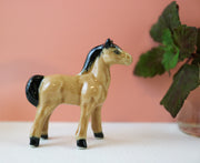 Miniature brown horse figurine