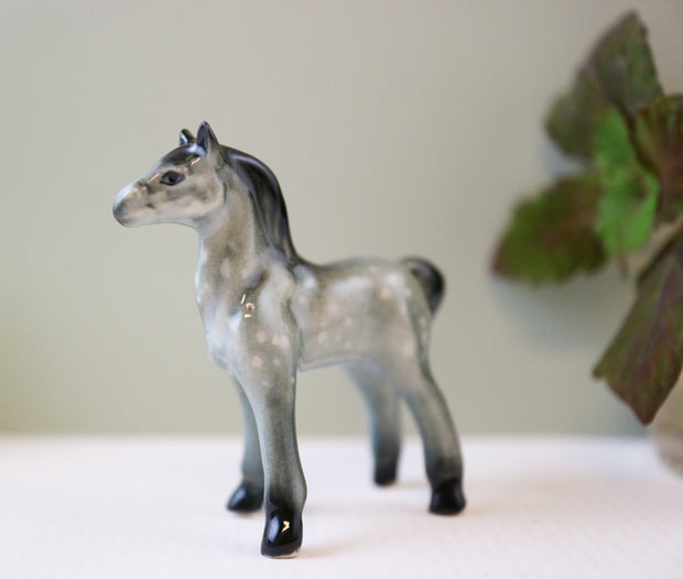 Miniature dapple grey horse figurine