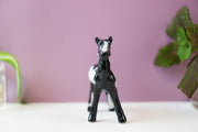Miniature black and white horse figurine