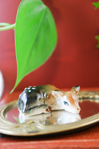 Miniature sleepy deer figurine