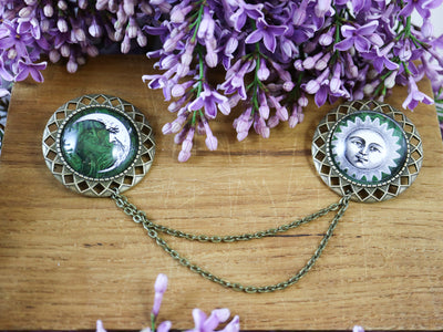 Green sun & moon collar brooch