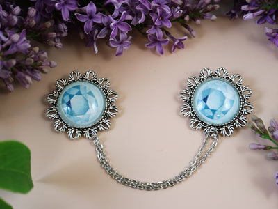 Blue gemstone collar brooch