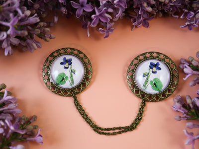 Modest violet collar brooch