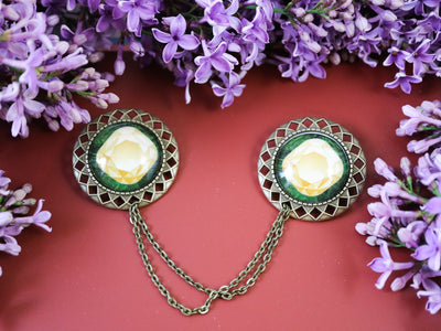 Yellow gemstone collar brooch