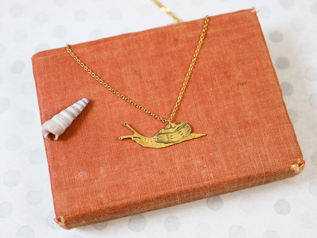 The curious snail hand sawed & engraved brass necklace